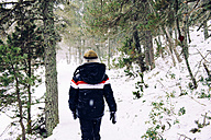 Boy walking through the woods in winter - GEMF000076