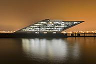 Germany, Hamburg, Altona, Modern office building Dockland in the evening - RJ000401