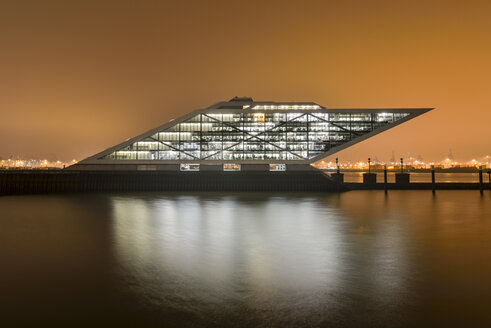 Germany, Hamburg, Altona, Modern office building Dockland in the evening - RJ000401