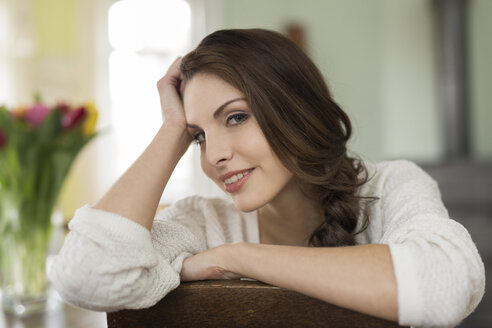 Portrait of brunette young woman at home - SHKF000274