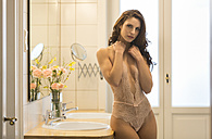 Sensual young woman in lingerie in bathroom - SHKF000292