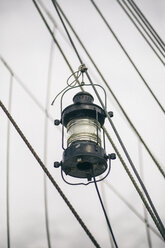Germany, Bremerhaven, latern hanging at rigging of a ship - ASCF000044