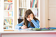 Frustrated girl doing homework - LVF002959