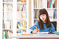 Girl doing homework - LVF002960