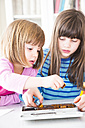 Two girls with box of letter stamps - LVF002956
