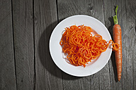 Carrot spirals on plate and wood - CSF024740