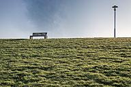 Germany, Neuharlingersiel, empty bench on dike - FRF000214
