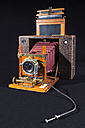 Old field camera in front of black background - WEF000330