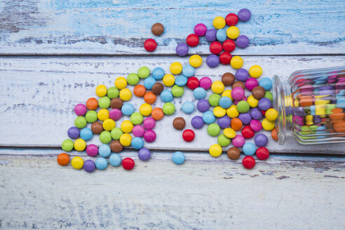 Smarties and candy jar on light blue wood - LVF002975