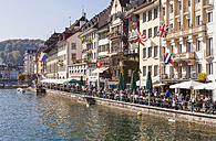 Switzerland, Luzern, row of houses and outdoor gastronomy at riverside of Reuss - WD002976