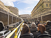 Italy, Rome, Tourists doing sightseeing tour in tour bus, passing Colosseum - LA001361