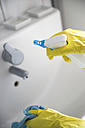 Woman's hand cleaning bathroom sink - CHPF000100
