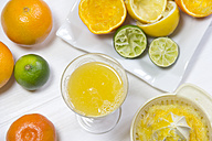 Glass of freshly squeezed juice from oranges, lemons and limes - YFF000340