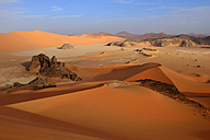 Africa, Algeria, Sahara, Tassili N'Ajjer National Park, Tadrart region, sand dunes and clay pan of southern Oued in Tehak - ES001547