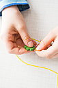 Hands of a girl stringing pearl - LVF003001