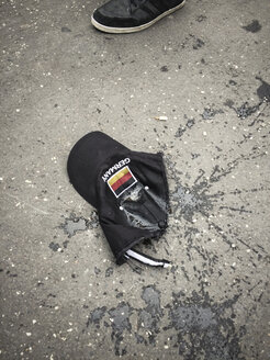 Dirty Germany cap on pavement - GCF000046