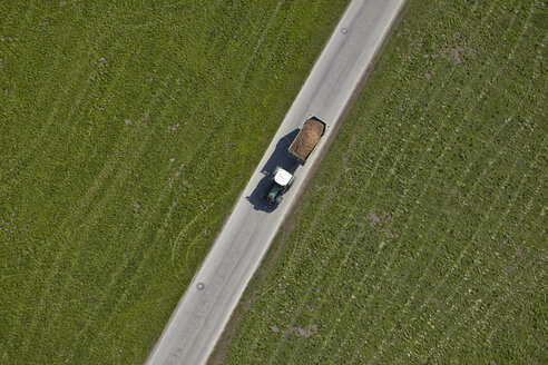 Germany, Bavaria, Aerial view of tractor with trailer - KDF000688