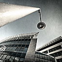 Germany, Wuppertal, office building and street lamp, low angle view - DWIF000454