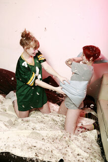 Pillow fight between two female friends at home - VEF000052