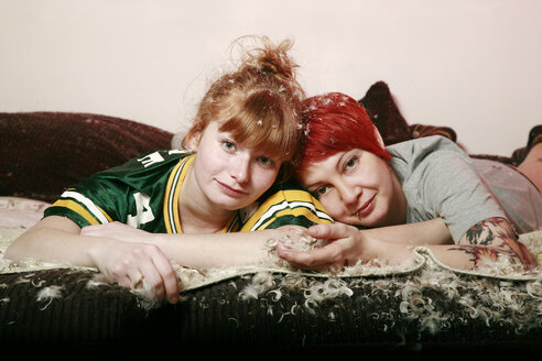 Portrait of two female friends after pillow fight at home - VEF000054