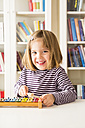 Portrait of happy little girl playing xylophones - LVF003043