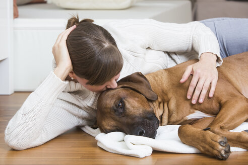 Woman caressing her Rhodesian Ridgeback dog - JTLF000054