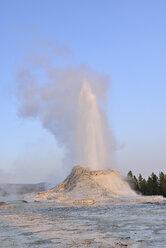 USA, Wyoming, Yellowstone National Park, Castle Geyser erupting - RUEF001568