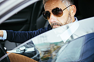 Man with sunglasses driving car - MBEF001331