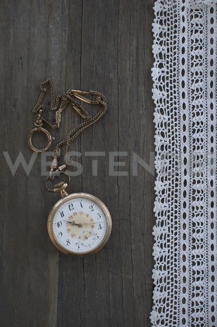 Old pocket watch and lace on dark wood - CRF002649