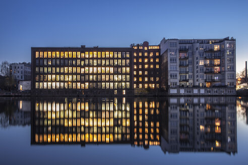 Germany, Berlin, lighted office building and water reflections in the evening - ZMF000375