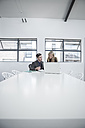 Businessman and businesswoman having an office meeting - ZEF004510