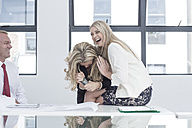 Businesswoman in office laughing happily - ZEF004548