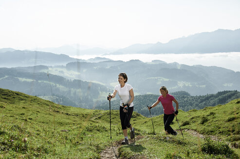 Austria, Two women Nordic walking at Kranzhorn - MAOF000066