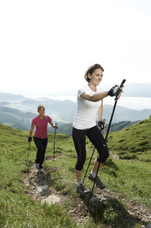 Austria, Two women Nordic walking at Kranzhorn - MAOF000068