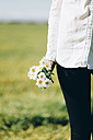 Cropped view of woman with flowers outdoors - JPF000027