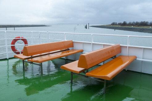 Germany, Bensersiel, empty tourboat in rain - WIF001572