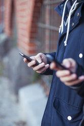 Hand of teenage boy with smartphone - MMFF000512
