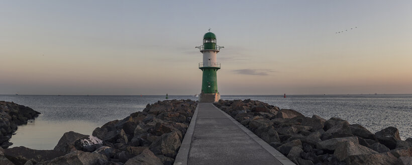 Germany, Warnemuende, lighthouse at dawn at the Baltic Sea - MELF000047