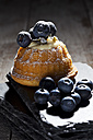 Mini Gugelhupf filled with ricotta and cream cheese garnished with blueberries - CSF024948