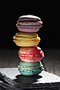 Stack of four different macarons on slate - CSF024949