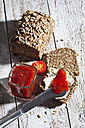 Slices of bread and glass of tomato jam - CSF024953