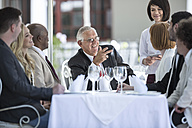Business people having business lunch in restaurant - ZEF004164