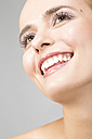 Portrait of smiling young woman looking up - MAEF009927