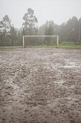 Spain, Galicia, Valdovino, muddy soccer field on a rainy day - RAEF000083