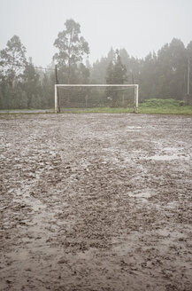 Spain, Galicia, Valdovino, muddy soccer field on a rainy day - RAEF000083
