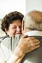 Hugging senior couple - UUF003575