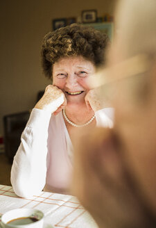 Portrait of senior woman looking at her husband - UUF003602