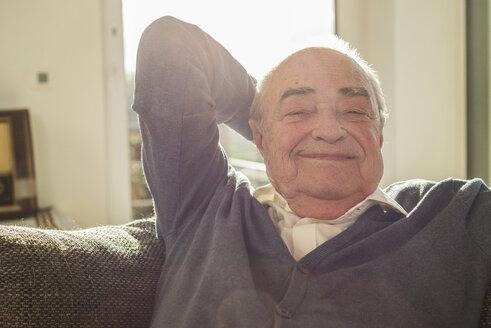 Portrait of happy senior man at home - UUF003621