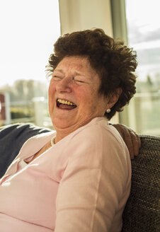 Portrait of laughing senior woman at home - UUF003648