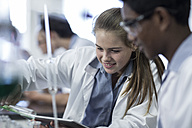 Two students in chemistry class working together - ZEF006152